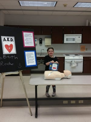 Beth Roche of Astico Perseverance demonstrates how to use an automated external defibrillator in a medical emergency.