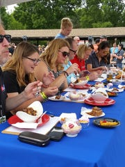 Judges dig into competitors' dishes during the 2017