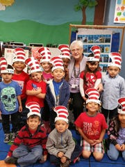 """Wearing hats that represent """"The Cat in The Hat"""" theme, these kindergartners from Lyndon B. Johnson Elementary participate in March in the Read Across America program."""