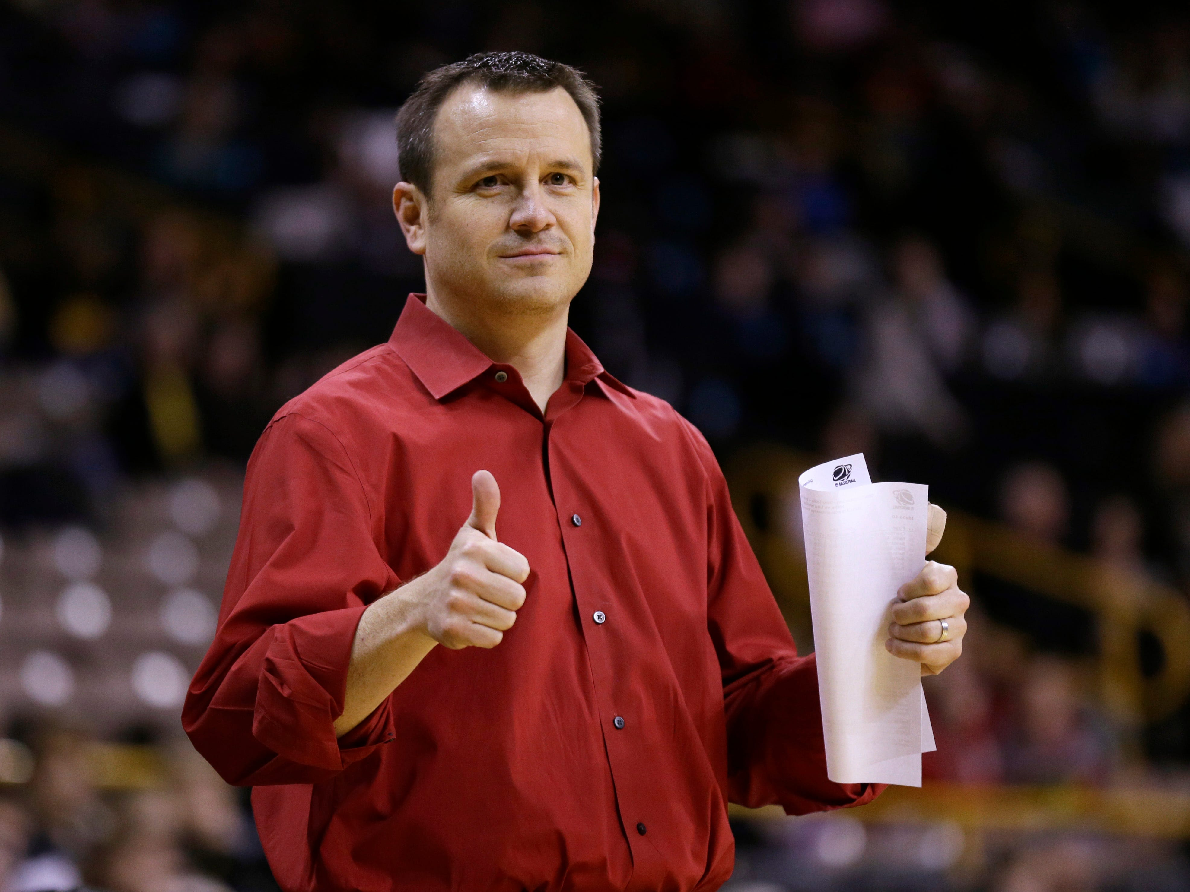 Louisville head coach Jeff Walz reacts on the bench during the second half of an NCAA tournament first-round women's college basketball game against Idaho, Sunday, March 23, 2014, in Iowa City, Iowa. Louisville won 88-42. (AP Photo/Charlie Neibergall)
