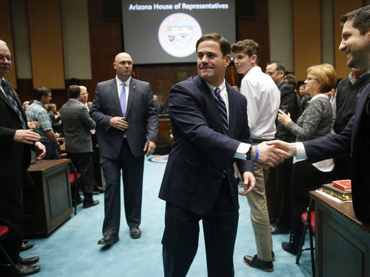 Gov. Doug Ducey shakes hands after giving his State
