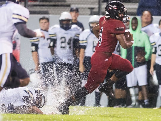 Brandon's Vincent Butler (4) breaks into the secondary against Pearl Friday in Brandon. (Bob Smith-Special to the Clarion Ledger)