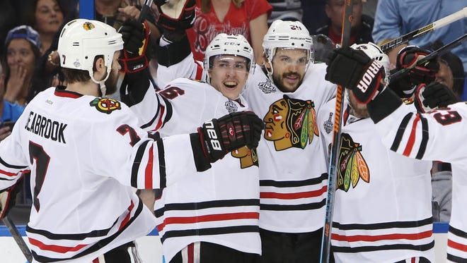 Chicago Blackhawks center Antoine Vermette (80) celebrates with teammates after scoring a goal against the Tampa Bay Lightning in the third period game five of the 2015 Stanley Cup Final at Amalie Arena.