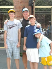 Barry Powers poses with his sons outside the National