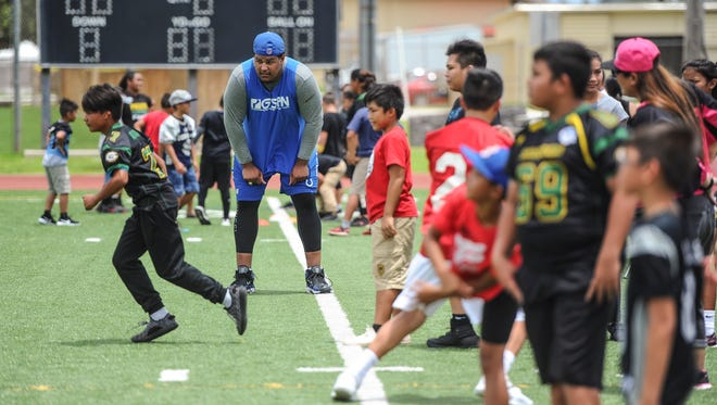Chamorro NFL draft pick Zach Banner instructs aspiring football athletes as they participate in the Zach Banner Football Festival at Guam High School in Agana Heights on Thursday, July 6, 2017.