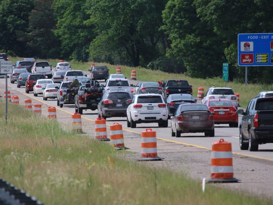 Traffic moves through a construction zone along northbound