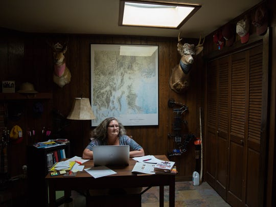 """Carol Potenza sits in her Las Cruces home, where she wrote """"Hearts of the Missing,"""" the mystery novel that won her the 2017 Tony Hillerman Prize. Friday July 14, 2017"""
