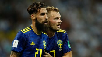 Sweden's midfielder Jimmy Durmaz (left), shown here with midfielder Sebastian Larsson, delivered a powerful anti-racism message after he received threats. Durmaz conceded a free kick against Germany on June 23.