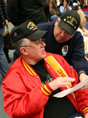 Veterans John Leighton of Congers and Ted Goodman of New City chat before a Clarkstown school board meeting Jan. 22. Veterans in attendance that night were there to speak about the school district giving veterans a partial exemption on school property taxes.