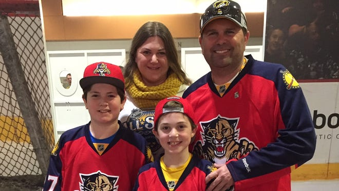 Scott, right, wife Liraz and their sons Ethan, left, and Aidan moved to Nashville from Fort Lauderdale, Fla. They root for the Panthers and Predators.
