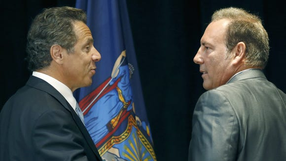Gov. Andrew Cuomo chats with Republican Sen. Joe Robach