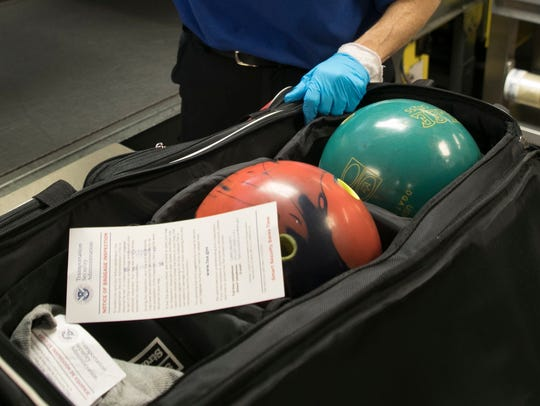 A pair of bowling balls were checked by Transportation