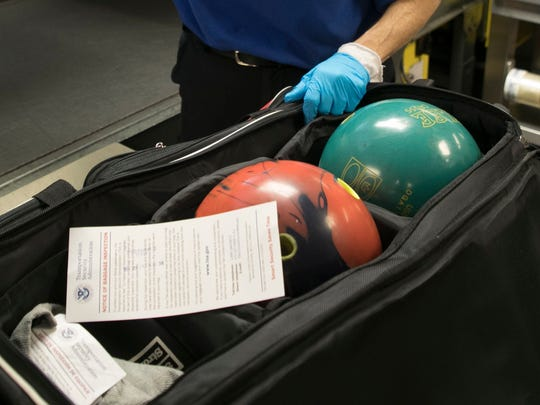 A pair of bowling balls were checked by Transportation Security Officer at Southwest Florida International Airport on Monday.