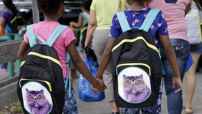 Students head back to school in Miami on Aug. 15, 2015.