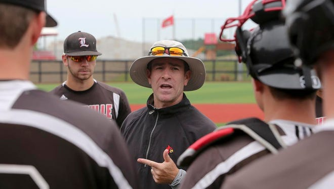 UofL coach Dan McDonnell talks to his players during practice. June 9, 2014.