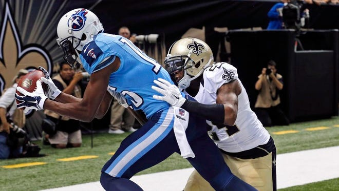 Tennessee Titans wide receiver Justin Hunter pulls in a touchdown reception over New Orleans Saints cornerback Corey White in the first half on Friday.