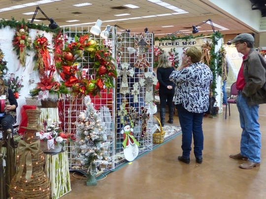 A wall of wreaths presents a holiday dilemma for this shopper.