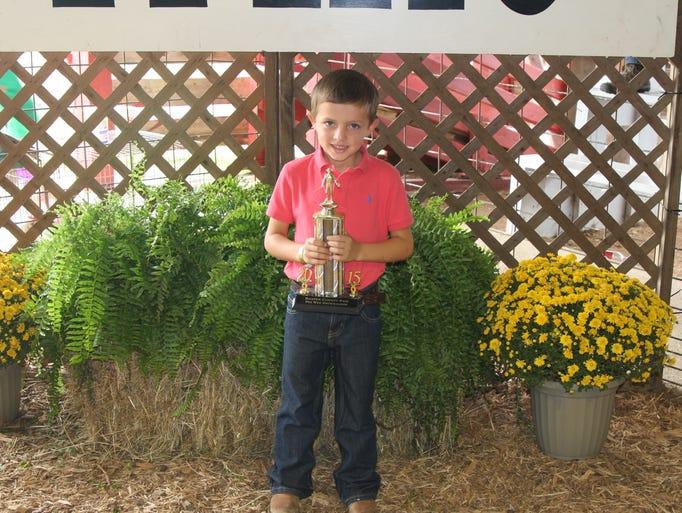 Harrison Baker is the winner of Peewee Meat Goat Showmanship.