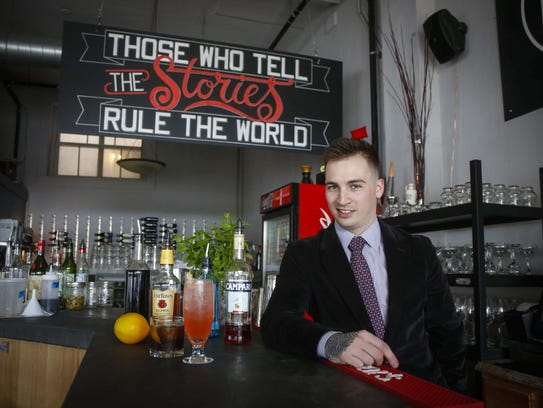 Jared Giunta, a bartender at Proof restaurant in Des