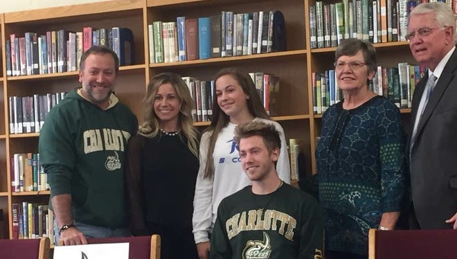 West Henderson senior Dylan Shamburger has signed with the Charlotte cross country and track programs.