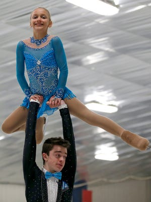 Eric Hartley, 16, of Evendale and partner Kate Finster, 11, of Louisville, Kentucky, won the gold medal in the novice pairs category at the U.S. Figure Skating Championships.