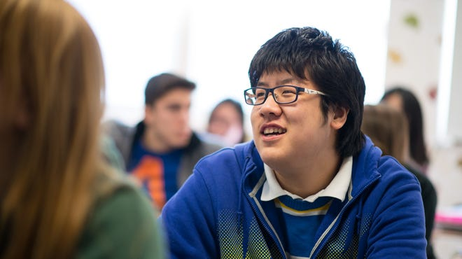 Che Sun of China listens during math class at Newcomb Central School in Newcomb, N.Y., in Februrary. International students are flocking to U.S. high schools.