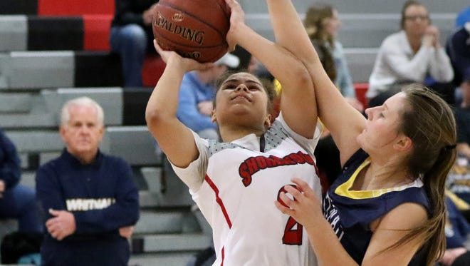 Shorewood's Jazmine Burns goes up for two points against Whitnall'sKathryn Bay at Shorewood on Jan. 12.