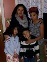Roxana Jimenez with her children from left, Alondra,