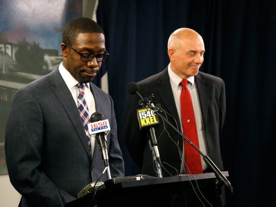 Waterloo Mayor Quentin Hart, left, pauses as he addresses community concerns of the status of Safety Services Director Dan Trelka's job at a press conference at City Hall Monday, Sept. 19, 2016, in Waterloo, Iowa. Trelka will now be in charge of just the police and not the fire department.