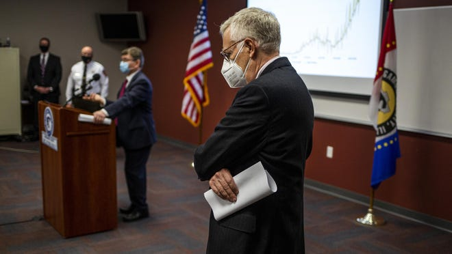 """Sangamon County Board Chairman Andy Van Meter listens as Springfield Mayor Jim Langfelder talks about lives being lost to COVID-19 during a press conference to talk about a """"phased approach"""" to mitigations at the Sangamon County Department of Health, Tuesday, November 3, 2020, in Springfield, Ill."""