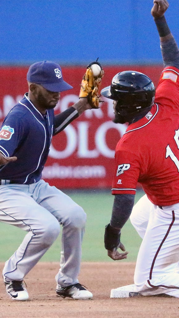 San Diego Padres infielder Alexei Ramirez, left, caught a throw to second base just in time to tag Yelson Asencio, 15, of the El Paso Chihuahuas out during their exhibition game Thursday night at Southwest University Park.