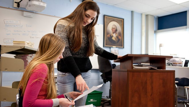 Richmond seniors Katie Townsend, 17, and Sara Campbell, 17, practice their roles as witness and lawyer Tuesday at Richmond High School.