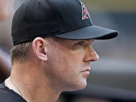 Diamondbacks manager A.J. Hinch watches his team at Chase Field in 2010.