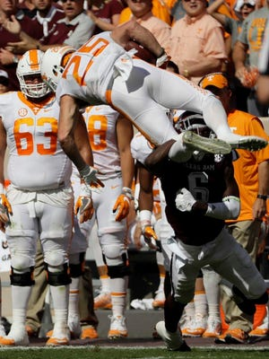 Tennessee's Josh Smith (25) is hit by Texas A&M defensive back Donovan Wilson (6) while returning a kick during the first half of an NCAA college football game Saturday, Oct. 8, 2016, in College Station, Texas.
