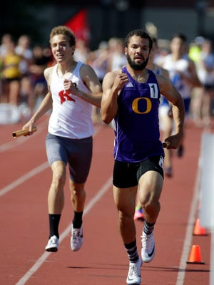 Parker Ellis (right) anchored Oconomowoc's Division 1 winning 3,200-meter relay team on Friday night and rallied the Racoons into the final of the 1,600 relay with a sterling final leg in the qualifying heats.