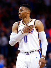 Oklahoma City Thunder guard Russell Westbrook taps his chest after his 16th rebound of the night, during the second half of an NBA basketball game against the Memphis Grizzlies, securing his triple-double average for the second straight season, in Oklahoma City, Wednesday, April 11, 2018.