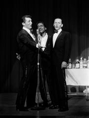 "Frank Sinatra, right, holds court with ""Rat Pack"" cohorts"