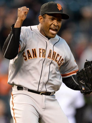 Giants relief pitcher Santiago Casilla reacts to the