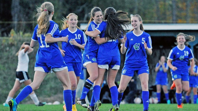 Colchester's Autumn Hathaway hugs her sister, Summer, after Summer's game-tying goal in the Lakers' 2-1 come-from-behind win over St. J Academy in a Division I girls soccer game at Cary Field on Tuesday.