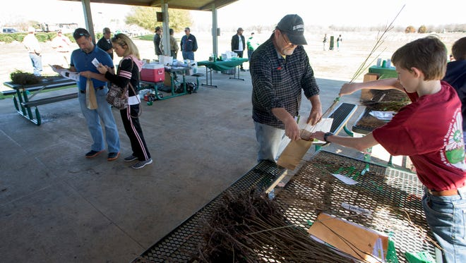 Montgomery Trees hold its ninth annual seeding giveaway at Ida Belle Young Park in Montgomery, Ala., as part of Alabama Arbor Week on Saturday February 25, 2017.