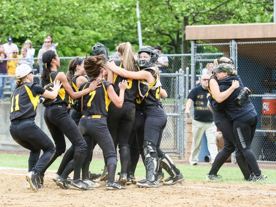 South Brunswick celebrates a 7-4 win in the ninth inning