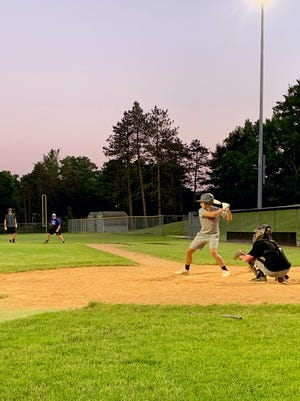 Members of the Cambridge Senior team get in a practice on Tuesday evening at Don Coss Field in preparation for tonight's opening day nine-inning matchup with Marietta, scheduled for a 5:30 p.m. start time at Don Coss Field.