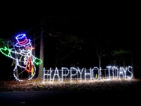 The Lake Julian Park was filled with light displays during the Lake Julian Festival of Lights on Tuesday, Dec. 15, 2015. The drive-through light show runs through Dec. 23 from 6 p.m. to 9 p.m. A percentage of proceeds will benefit the local Special Olympics program.