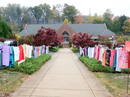 Mars Hill University sponsored The Clothesline Project, an international project started in 1999, for the 16th year by hanging t-shirts made by students, staff and community members that have been victims of domestic violence on lines outside of the dining hall on Thursday, Oct. 27, 2016. The project aims to shed light on the problems of domestic violence.