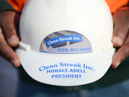Horace Adell, president of Clean Streak Inc. holds his specialized hard hat at a job site in Hendersonville on Tuesday, Jan. 10, 2017. Adell's business is one of few black-owned businesses that got contracts for work with the City of Asheville in 2015.