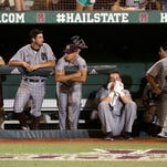 Mississippi State team members remain in the dugout after Arizona scored the winning run in the 11th inning of an NNCAA college baseball tournament super regional game in Starkville, Miss., Saturday, June 11, 2016. Arizona won 6-5. (AP Photo/Jim Lytle)