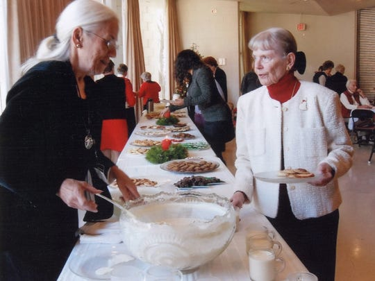 Three Rivers Woman's Club members Linda Lewis and Lynn McIntyre during the 2011 Christmas Luncheon.