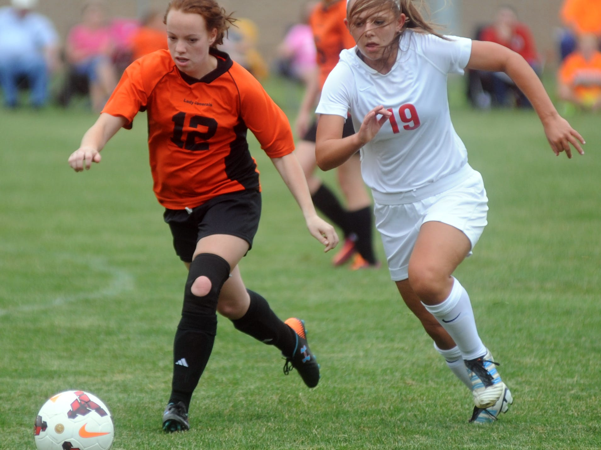 Ridgewood's Hollie Schwab and Coshocton's Emily Hartley fight for the ball during Thursday's game.