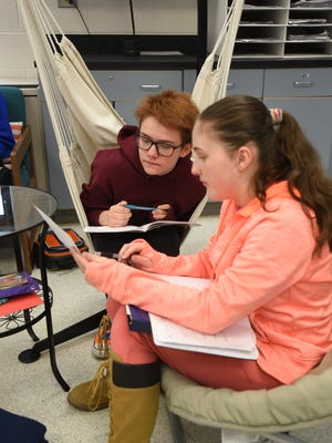 Oak Valley Middle School students Ava Adams, left, and Mikayla Porter like their comfy chairs in science class at Oak Valley Middle School.