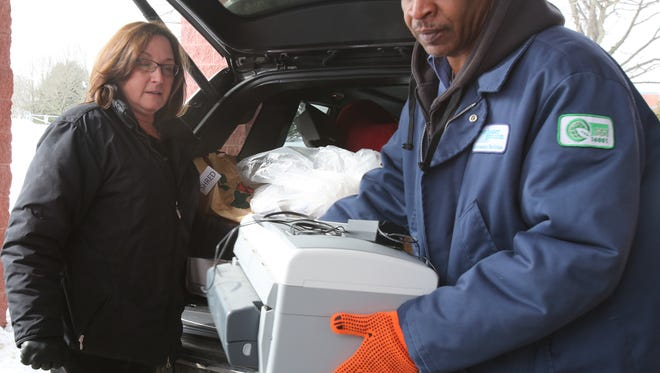 Lee Brannan of Clean Venture helps Martha Gary of Scarsdale as she drops off a printer at the Westchester County Department of Environmental Facilities  March 3, 2015. Clean Venture has a contract with Westchester to collect and properly dispose of household waste.